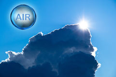 Word air in a bubble on a dramatic sky. A bubble with the word air in and the sun shining on the top of a large storm clouds Royalty Free Stock Photo