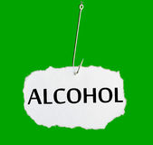 Word ALCOHOL on a fishing hook Royalty Free Stock Photography