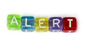 Word alert. White cubes stock photography