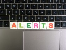Word Alerts on keyboard background.  royalty free stock photo