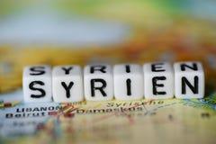 Word allemand SYRIEN a formé par des blocs d'alphabet sur la carte d'atlas Image libre de droits
