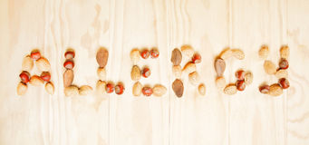 Word allergy written of different nuts Royalty Free Stock Photo