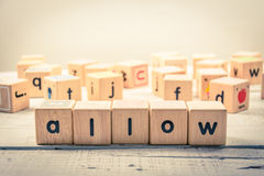 Word ` allow ` wood Cubic on the wood.  stock photos