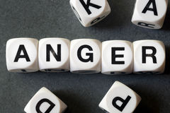 Word anger on toy cubes. Word anger on white toy cubes stock photography