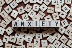 The word of ANXIETY on building blocks concept royalty free stock photos