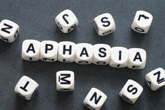 Word aphasia on toy cubes Stock Photography