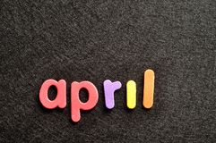 April on a black background Royalty Free Stock Images
