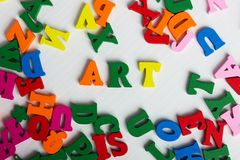 The word art from the colorful wooden letters. On a white wooden background stock image