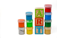 Word Art constructed with wooden blocks surrounded by paint bott Royalty Free Stock Images