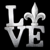 Word Art Love with Fleur de Lis. Vintage Antique Wooden Love Word Art with fleur de lis symbol New Orleans Royalty Free Stock Photos