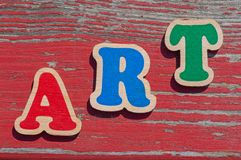 Word art made of color letters. On old wooden board stock photography