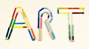 The word ART made with oil pasteles. From above stock photos