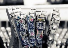 The word ART with old typewriter hammers. In monochrome royalty free stock images