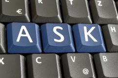 Word Ask spekked on computer keyboard. Word Ask spelled with blue keys on computer keyboard Stock Images