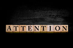Word ATTENTION isolated on black background Stock Photography
