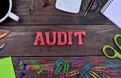 The word Audit on table. The word Audit on wooden table Stock Photography