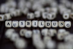 Word AUSBILDUNG on wooden cubes or blocks - educational background. Wood ABC Royalty Free Stock Photo