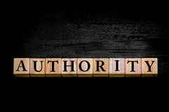 Word AUTHORITY isolated on black background Stock Photos