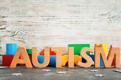 Word. `Autism` and building blocks on table Stock Photography