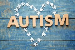 Word AUTISM made with letters. On wooden background Stock Photos
