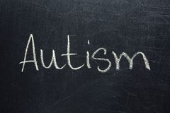 Word AUTISM written on board. Word AUTISM written on chalk board Stock Photography