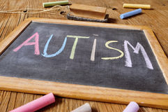 Word autism written in a chalkboard Stock Image
