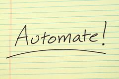 Automate! On A Yellow Legal Pad. The word `Automate!` underlined on a yellow legal pad Stock Photography