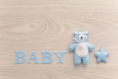 Word baby and blue toy bear Royalty Free Stock Photos
