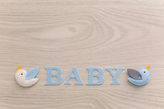 Word baby and blue toy Stock Photo