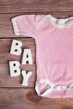 Word baby and child clothing Stock Photos