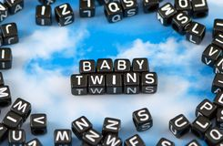 The word baby twins. On the sky background stock photos