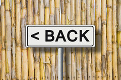 The word Back written on a road sign Royalty Free Stock Photo