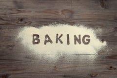 Word baking written in white flour Royalty Free Stock Image