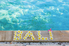 Word Bali written with frangipani flowers Stock Images