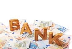 Word Bank over de stapel van geld Royalty-vrije Stock Foto's