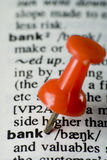 Word bank and red pin. A word BANK and red pin in dictionary royalty free stock images