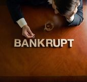 Word Bankrupt and devastated man composition Stock Images
