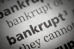 Word bankrupt in glossary, super macro Royalty Free Stock Photo