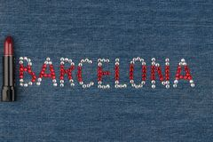 Word Barcelona, made of rhinestones, encrusted on denim. World Fashion. Stock Photos