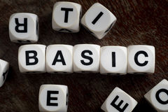 Word basic on toy cubes Stock Photos