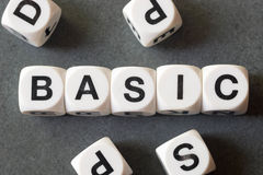 Word basic on toy cubes. Word basic on white toy cubes royalty free stock images