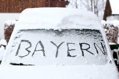 The word Bayern on a snowy windscreen. Of a car stock photos
