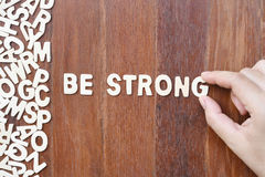 Word be strong  made with block wooden letters Stock Photos