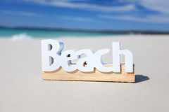 The word beach on the seashore Stock Image