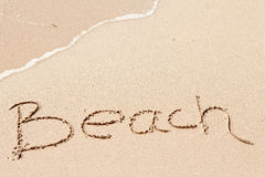 Word Beach written on the beach Stock Images