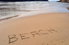 The word Beach written in the sand. Beach with the word beach written in the sand Stock Images