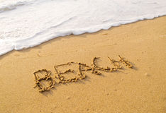 Word beach written in the sand beach Royalty Free Stock Photography