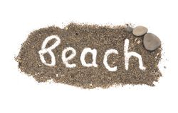 The word beach is written on sand on isolated background. The word beach is written, lined, on the sand on an isolated background stock image