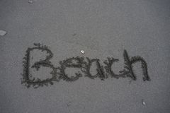 The word beach written in the sand Stock Images