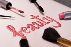 Word `beauty` written in lip gloss Stock Images